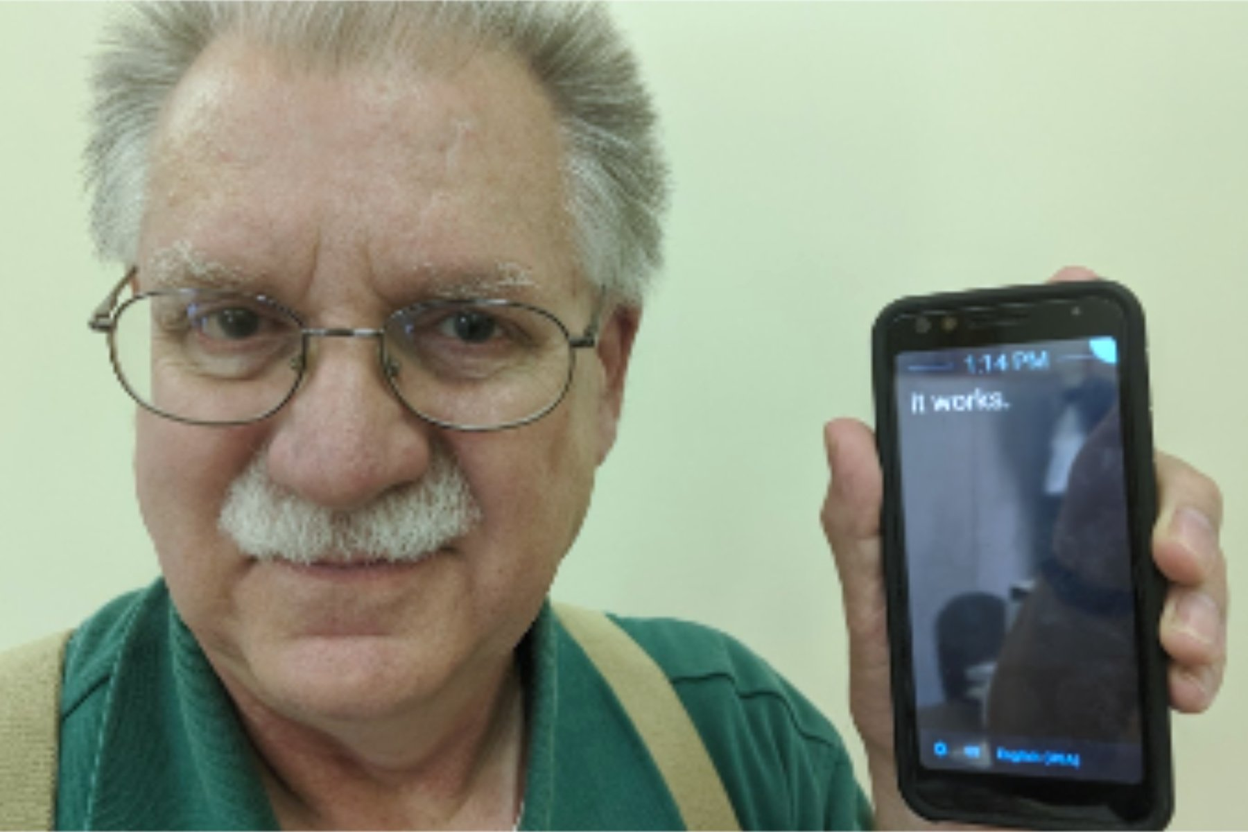 Photo of Deaf Man With Phone