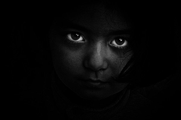 Child's eyes in the dark