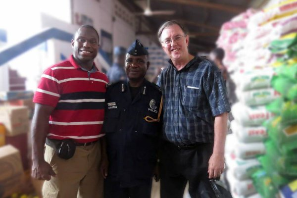 David Bennett with Deaf missionary and police officer