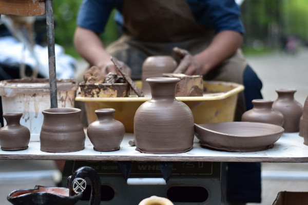 Potter making clay vessels