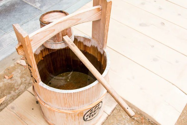 wooden bucket and dipper
