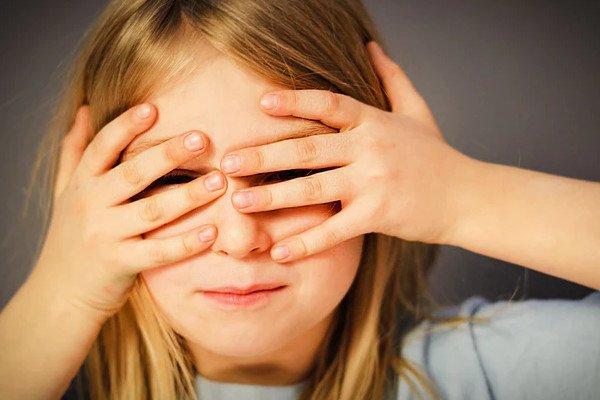 girl hiding face